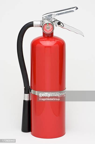 A singular red fire extinguisher