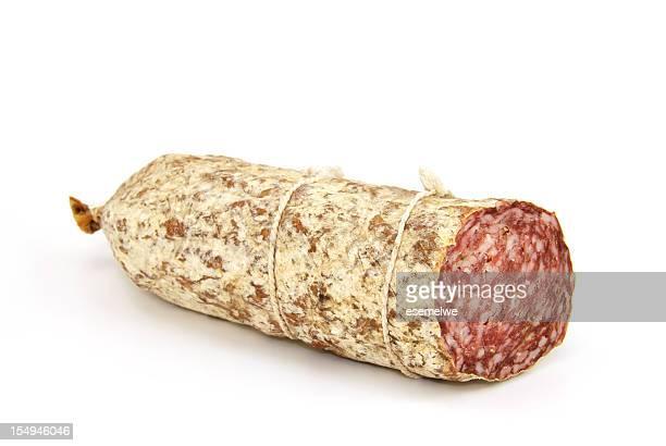 A singular salami sausage on white