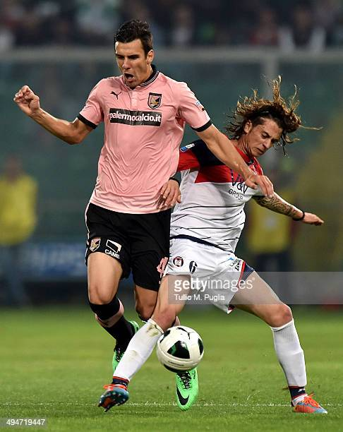 Sinisa Andelkovic of Palermo and Jacopo Dezi of Crotone fight for the ball during the Serie B match between US Citta di Palermo and FC Crotone at...