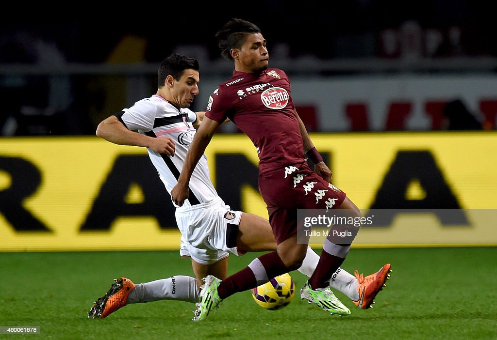Sinisa Andelkovic (L) of Palermo and Josef Martinez of Torino compete for the ball during the Serie A match between Torino FC and US Citta di Palermo at Stadio Olimpico di Torino on December 6, 2014 in Turin, Italy.