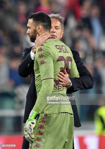 Sinisa Mihajlovic head cach of Torino FC embraces Salvatore Sirigu of Torino FC after the Serie A match between Juventus and Torino FC on September...