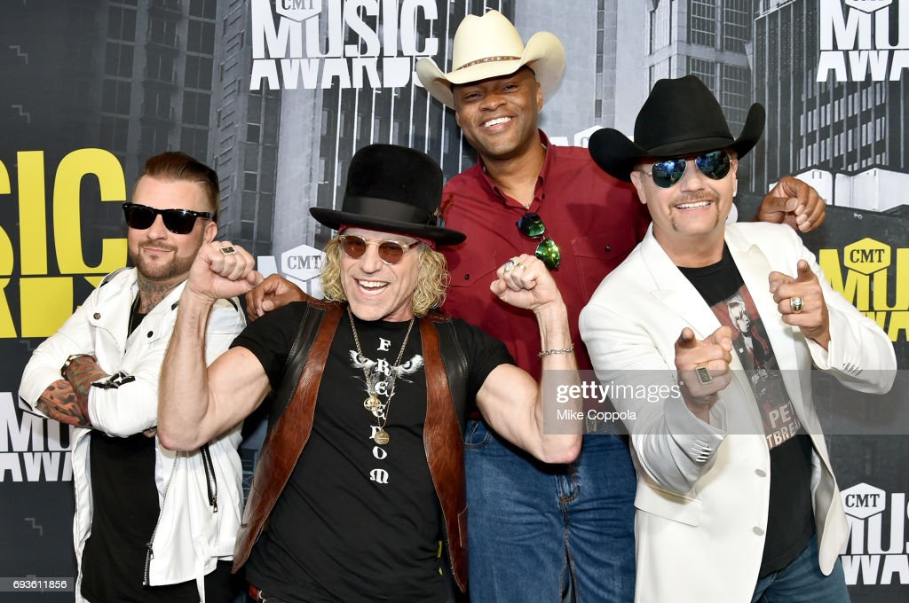 DJ Sinister, Big Kenny Alphin, Cowboy Troy, and John Rich attend the 2017 CMT Music Awards at the Music City Center on June 7, 2017 in Nashville, Tennessee.