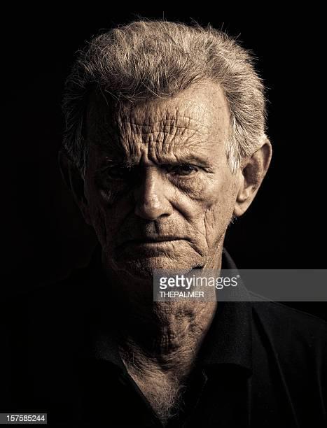 sinister senior man portrait