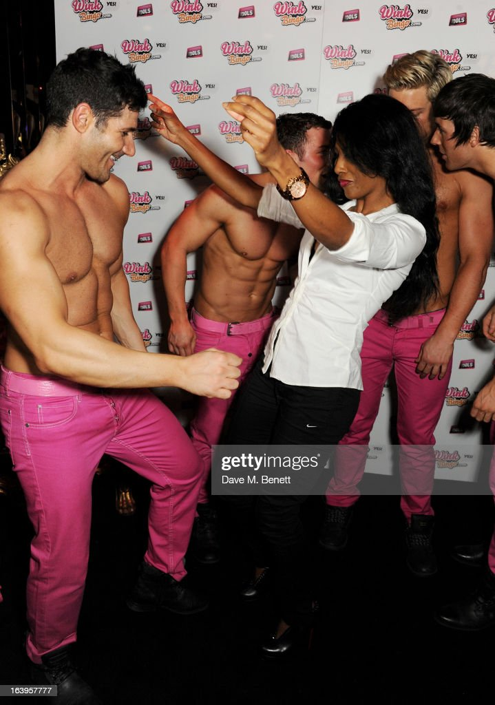 Sinitta dances with the Dream Idols at Wink Bingo's Gentle Woman's Night featuring a performance from The Dream Idols at Peter Stringfellow's Angels Club on March 18, 2013 in London, England.