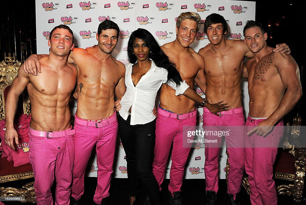 <a gi-track='captionPersonalityLinkClicked' href=/galleries/search?phrase=Sinitta&family=editorial&specificpeople=1797588 ng-click='$event.stopPropagation()'>Sinitta</a> (3L) poses with The Dream Idols at Wink Bingo's Gentle Woman's Night featuring a performance from The Dream Idols at Peter Stringfellow's Angels Club on March 18, 2013 in London, England.
