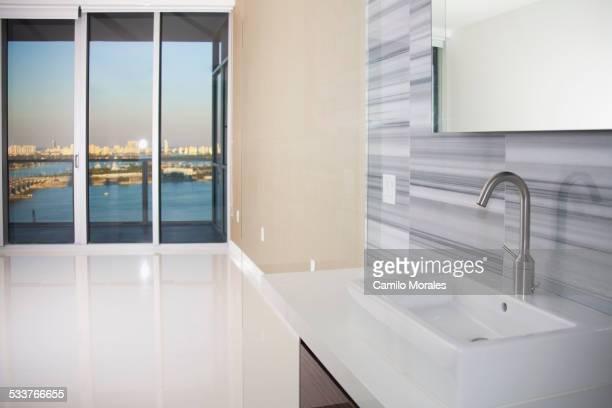 Sink, windows and countertop in modern kitchen