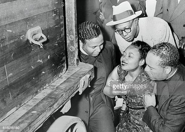 Sinking to knees Mrs Mamie Bradley weeps as body of slain son Emmett Louis Till 14 arrives at Chicago Rail Station The youth was found dead in a...