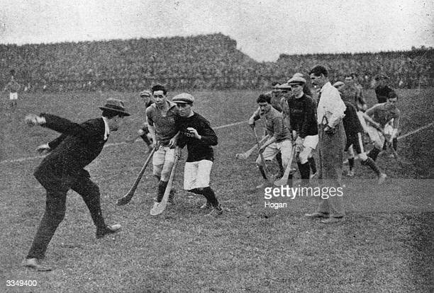 Sinn Fein leader and CommanderInChief of the Irish Free State Army Michael Collins throwing in the ball to start a hurling match at Croke Park Dublin...