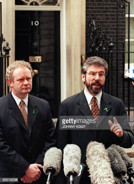 Sinn Fein leader Gerry Adams and chief negotiator Martin McGuinness talk to newsmen after leaving 10 Downing Street 27 April following talks with...