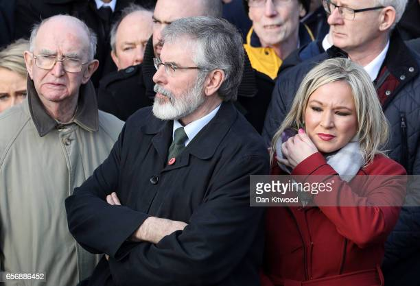 Sinn Fein President Gerry Adams and Northern Ireland Leader Michelle O'Neill look on after the funeral service at St Columba's Church on March 23...
