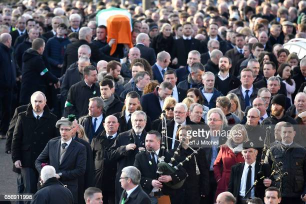 Sinn Fein President Gerry Adams and Northern Ireland Leader Michelle O'Neill lead mourners as the coffin of the late Martin McGuinness is carried to...