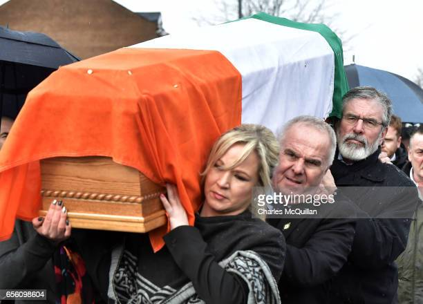 Sinn Fein President Gerry Adams and Sinn Fein Northern Ireland leader Michelle O'Neill carry the coffin of the late Martin McGuinness on March 21...
