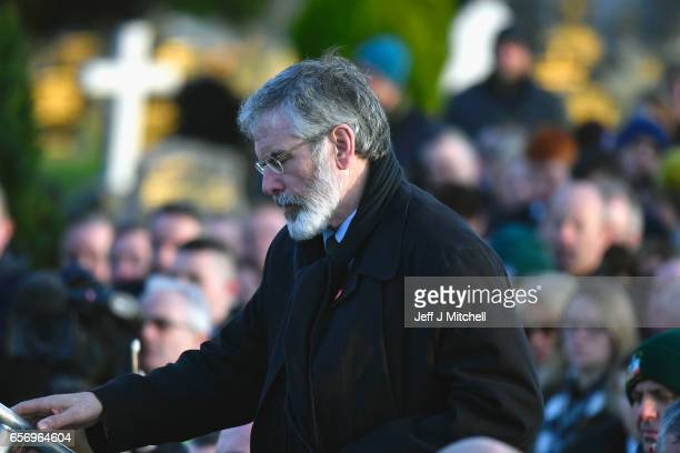 Sinn Fein President Gerry Adams attends Martin McGuinness' Funeral at the Derry City Cemetery on March 23 2017 in Londonderry Northern Ireland The...