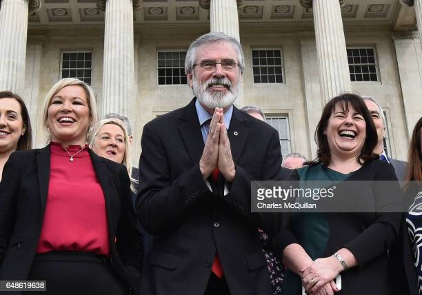Sinn Fein president Gerry Adams bows to a group of Japenese tourists as he attends a press call alongside northern leader Michelle O'Neill and...
