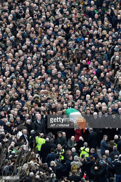 Sinn Fein President Gerry Adams carries the coffin of the late Martin McGuinness as the funeral cortege passes through the streets of Derry on March...
