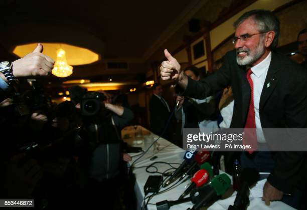 Sinn Fein president Gerry Adams receives a thumbs up after a press conference at the Balmoral Hotel Belfast after his release from custody at Antrim...