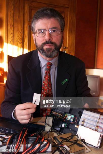 Sinn Fein president Gerry Adams revealing the discovery of what he claims is a 'highly sophisticated' listening and tracking device attached to a car...