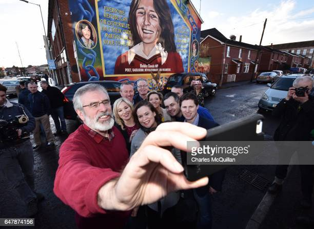 Sinn Fein President Gerry Adams southern leader Mary Lou McDonald and northern leader Michelle O'Neill take a selfie in front of the Bobby Sands...