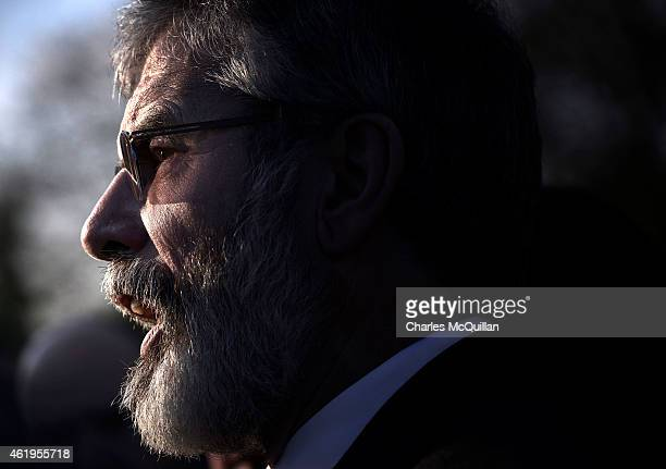 Sinn Fein President Gerry Adams talks with reporters after holding a meeting with Britain's Labour party leader Ed Miliband at Stormont Castle on...