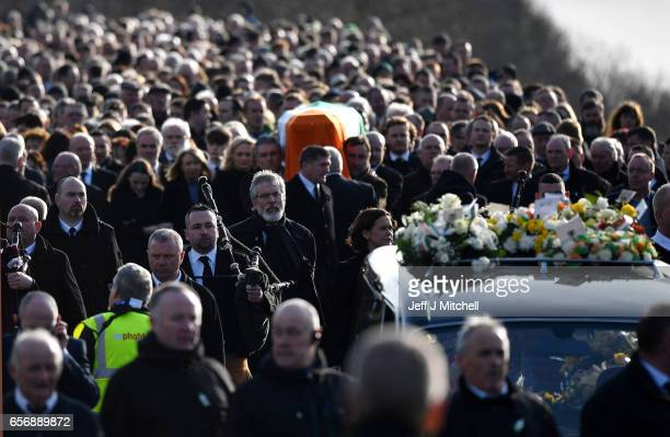 Sinn Fein President Gerry Adams walks with the funeral cortege leaves St Columba's Church and makes it way to Derry City Cemetery on March 23 2017 in...