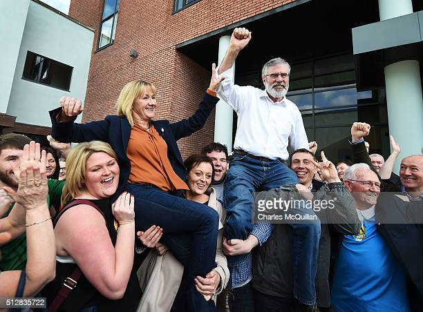 Sinn Fein's Gerry Adams and fellow County Louth candidate Imelda Munster are lifted in celebration after Adams was reelected to government at the...