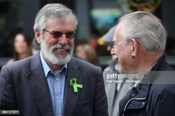 Sinn Fein's Gerry Adams speaks to artist Robert Ballagh before a memorial ceremony in Dublin's Talbot Street marking the anniversary of the bombings...