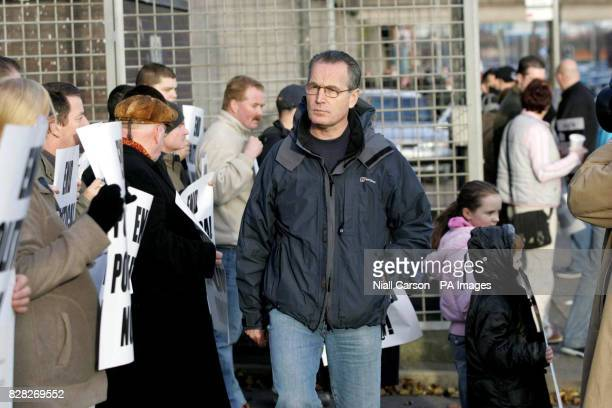 Sinn Fein's Gerry Kelly at a party picket outside North Queen Street Station in north Belfast Saturday December 17 2005 The picket was called in...