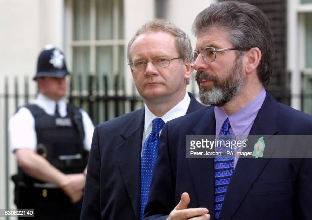 Sinn Fein's Martin McGuiness and Gerry Adams speak to the media before holding talks with British Prime Minister Tony Blair at Downing Street in...