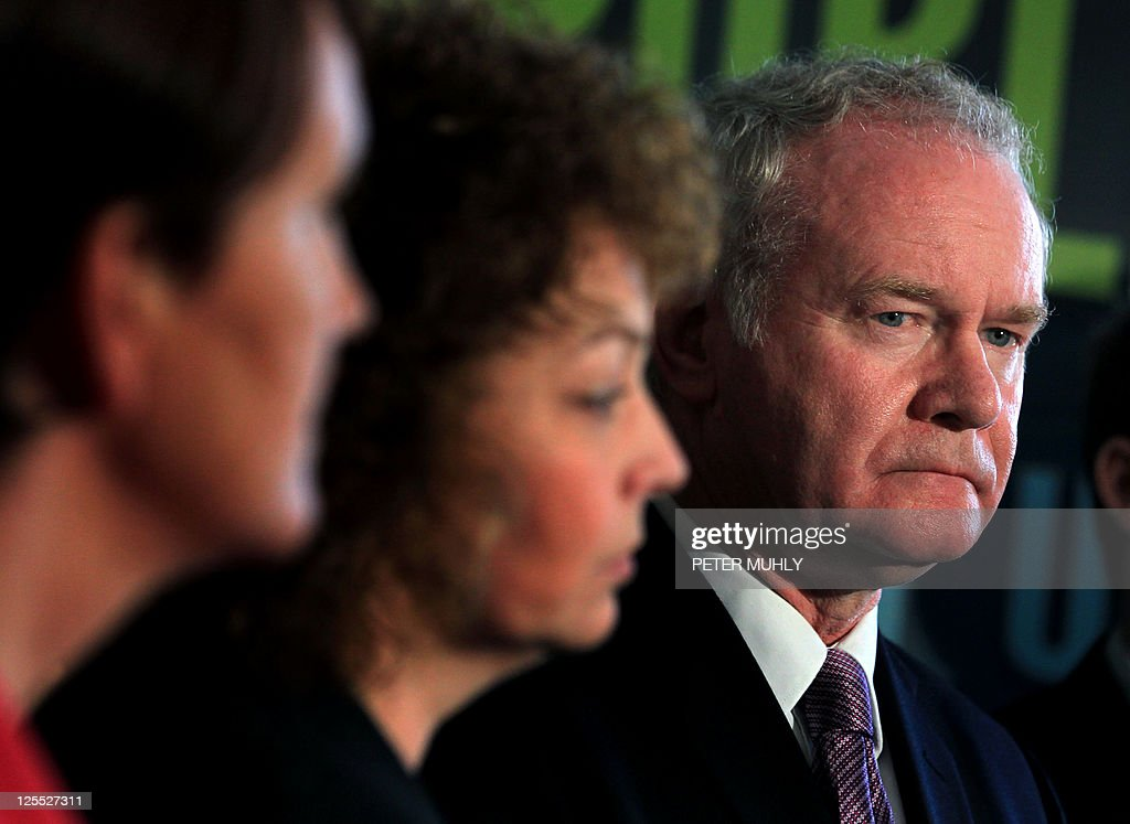 Sinn Fein's Martin McGuinness (R) stands with party colleagues as he prepares to speak to the media during a press conference, after being officially chosen by his party to be the candidate for the upcoming Irish Presidential election, at the Writers' Centre in Dublin, on September 18, 2011. Martin McGuinness, a former commander of the IRA and Northern Ireland's deputy first minister, was officially confirmed on Sunday as his Sinn Fein party's candidate for next month's Irish presidential election.