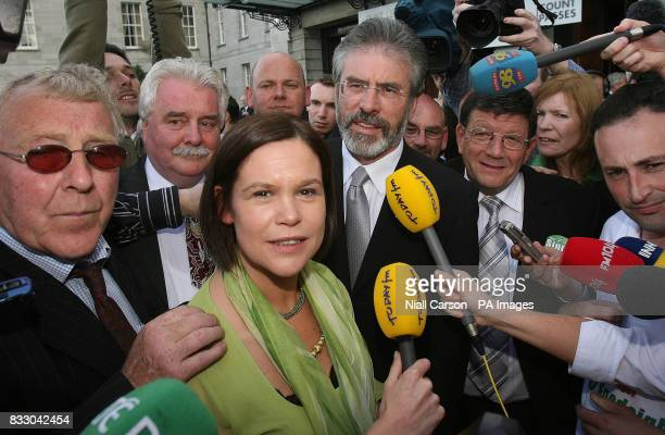 Sinn Feins Mary Lou McDonnell and party leader Gerry Adams speak to the media on their way into the Irish General Election count at the RDS in Dublin