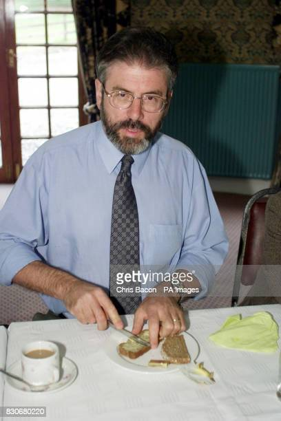 Sinn Fein's President Gery Adams tucks into light breakfast before the start of a meeting of the party's executive at a hotel in Castlebellingham Co...