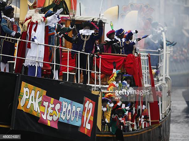 Sinterklaas and some men dressed as Zwarte Piet parade during the traditional movein 'Intocht Sinterklaas' event in Groningen Netherlands on November...