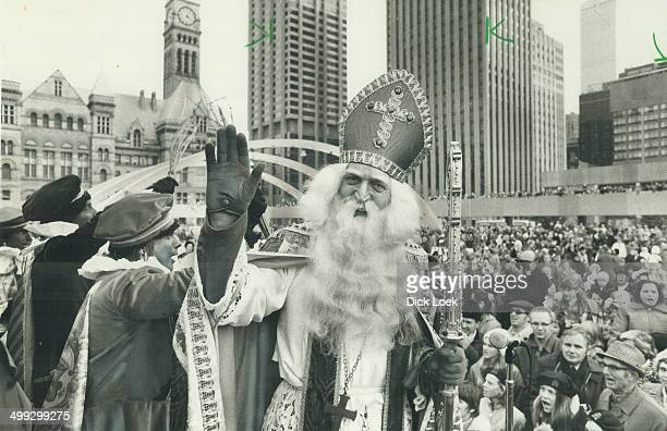 Sinterklaas the Dutch Santa Claus arrived in Toronto on Saturday to greet thousands of Metro residents With his helpers called Black Peters...