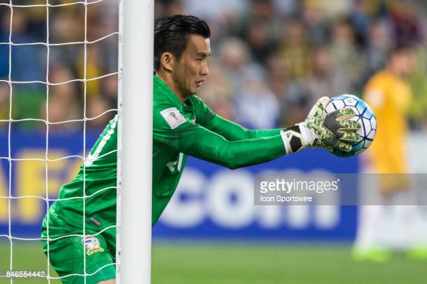 Sinthaweechai Hathairattanakool of the Thailand National Football Team saves another attempt at goal during the FIFA World Cup Qualifier Match...