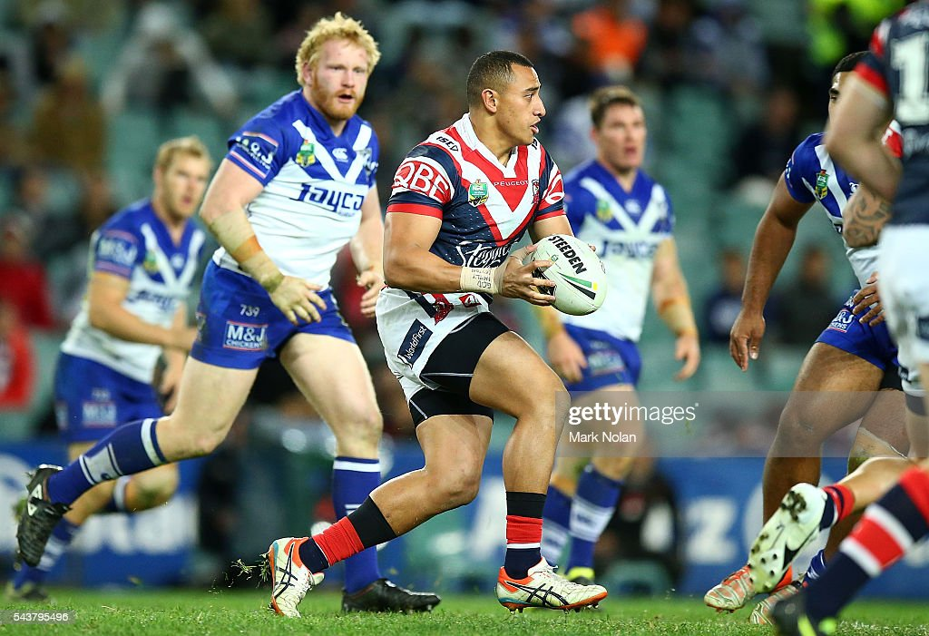 Sio Siua Taukeiaho of the Roosters runs the ball during the round 17 NRL match between the Sydney Roosters and the Canterbury Bulldogs at Allianz Stadium on June 30, 2016 in Sydney, Australia.