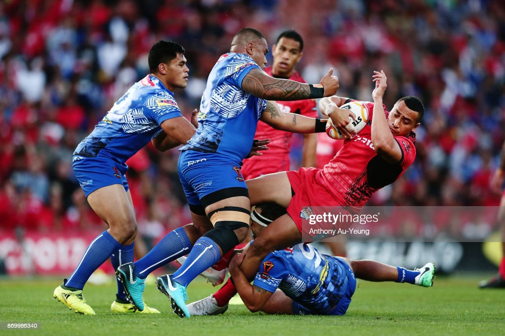 Sio Siua Taukeiaho of Tonga is tackled by Junior Paulo of Samoa during the 2017 Rugby League World Cup match between Samoa and Tonga at Waikato Stadium on November 4, 2017 in Hamilton, New Zealand.