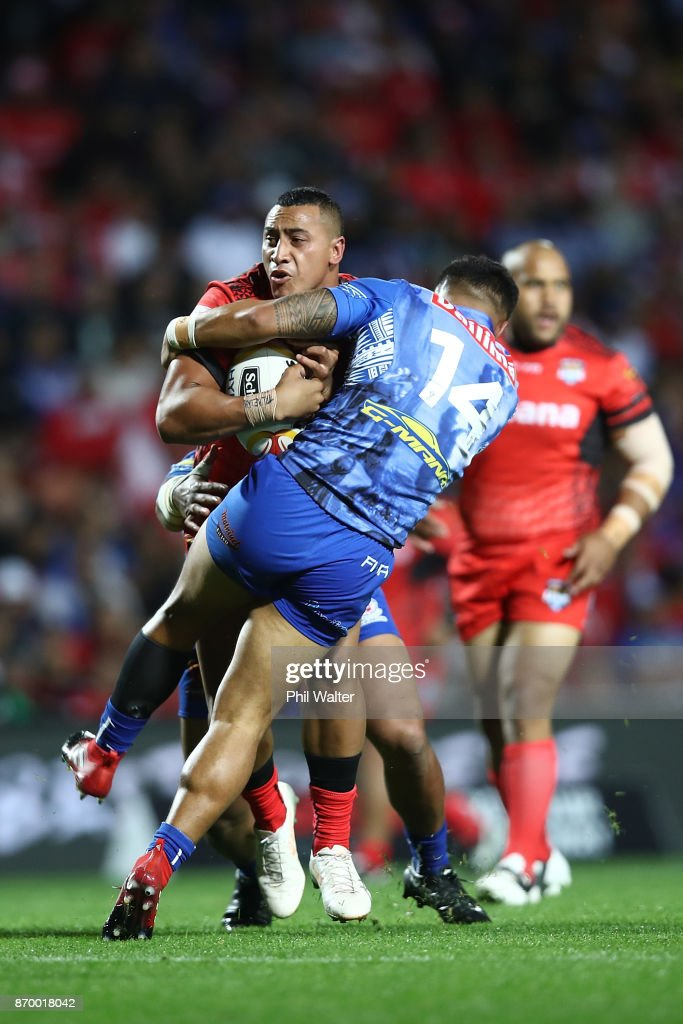 Sio Siua Taukeiaho of Tonga is tackled during the 2017 Rugby League World Cup match between Samoa and Tonga at Waikato Stadium on November 4, 2017 in Hamilton, New Zealand.