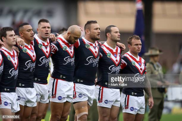 Sio Siua Taukeiaho Shaun KennyDowall and Jared WaereaHargreaves of the Roosters sing the New Zealand antional anthem during the Anzac Day ceremony...