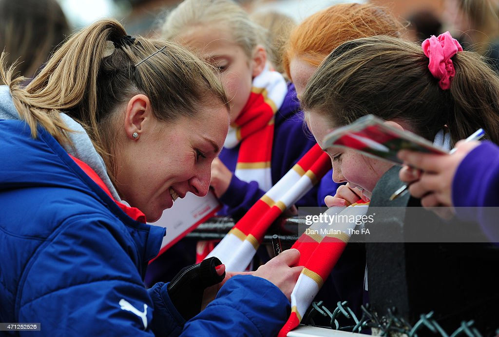Siobhan Chamberlain of Arsenal signs autographs for supporters following the WSL match between Arsenal Ladies and Sunderland Ladies at Meadow Park on...