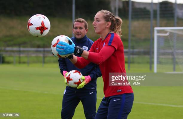 Siobhan Chamberlain of England Women is watched by goalkeeping coach Lee Kendall during the England Training Session on August 2 2017 in Utrecht...