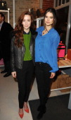 Siobhan Donaghy and SarahAnn Macklin attend The Cambridge Satchel Company launch of their East London pop up store on December 5 2013 in London...