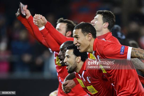 FC Sion players celebrate their qualification at the end of the UEFA Europa League group B football match between FC Sion and FC Liverpool at the...