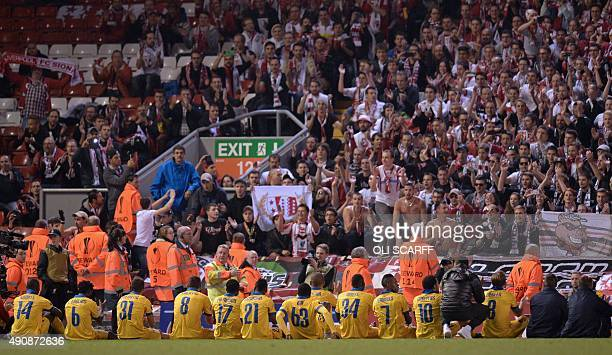 Sion players sit down near their supporters after the UEFA Europa League group B football match between Liverpool and FC Sion at Anfield in Liverpool...
