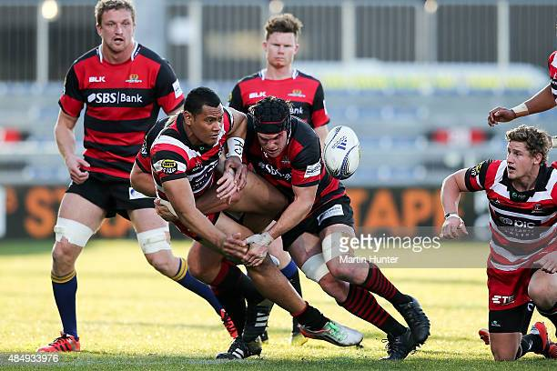 Sione Fifita of Counties Manukau looks to pass in the tackle of Matt Todd of Canterbury during the round two ITM Cup match between Canterbury and...