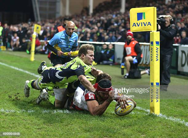Sione Kalamafoni of Gloucester dives over for a try during the Aviva Premiership match between Gloucester and Sale Sharks at Kingsholm on December 4...