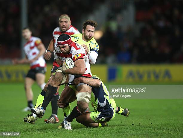 Sione Kalamafoni of Gloucester is tackled by Danny Cipriani and Tommy Taylor during the Aviva Premiership match between Gloucester and Sale Sharks at...