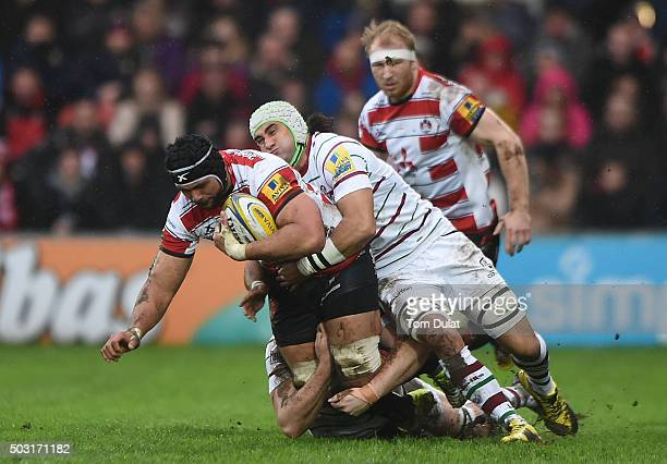 Sione Kalamafoni of Gloucester Rugby is tackled by Blair Cowan of London Irish during the Aviva Premiership match between Gloucester Rugby and London...