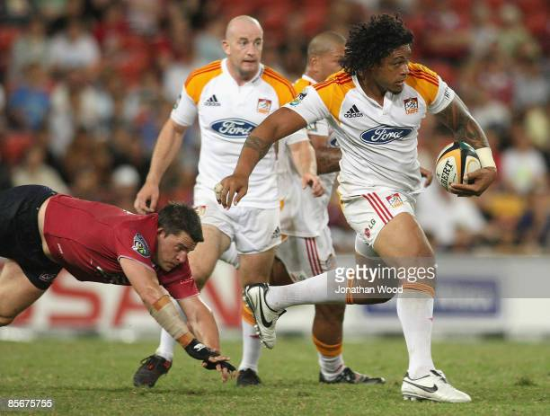 Sione Lauaki of the Chiefs in attack during the round seven Super 14 match between the Reds and the Chiefs at Suncorp Stadium on March 28 2009 in...