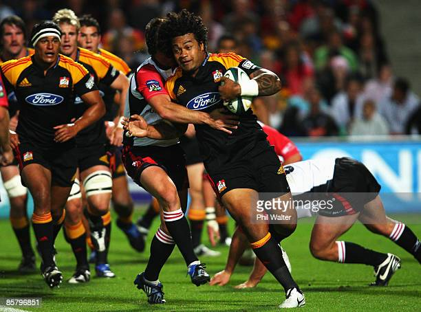 Sione Lauaki of the Chiefs is tackled by Doppies la Grange of the Lions during the round eight Super 14 match between the Chiefs and the Lions at...
