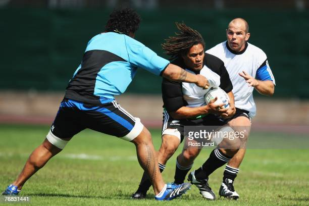 Sione Lauaki Rodney So'oialo and Anton Oliver of the New Zealand All Blacks during team training at Stade G Carcassone on September 18 2007 in...